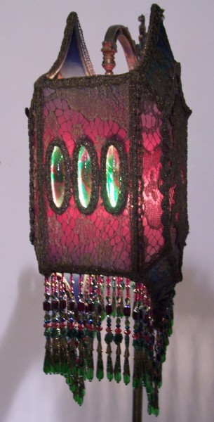 Victorian lampshades on period floor lamps fabulous old bridge lamp with ornate bird arm holds an ombre dyed red into green and inky blue tipped gothic diamond shaped shade that is a linda kenmore aloadofball Image collections